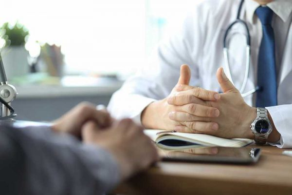 bigstock-Close-up-Of-Doctor-And-Patient-332730043